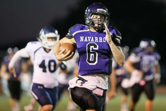 Navarro quarterback Will Eveld takes off on a 68-yard touchdown run on the opening play of the game duringtheir non-district football game with Central Catholic at Navarros's Erwin Lee Field on Friday, Oct. 6, 2017.  MARVIN PFEIFFER/mpfeiffer@express-news.net