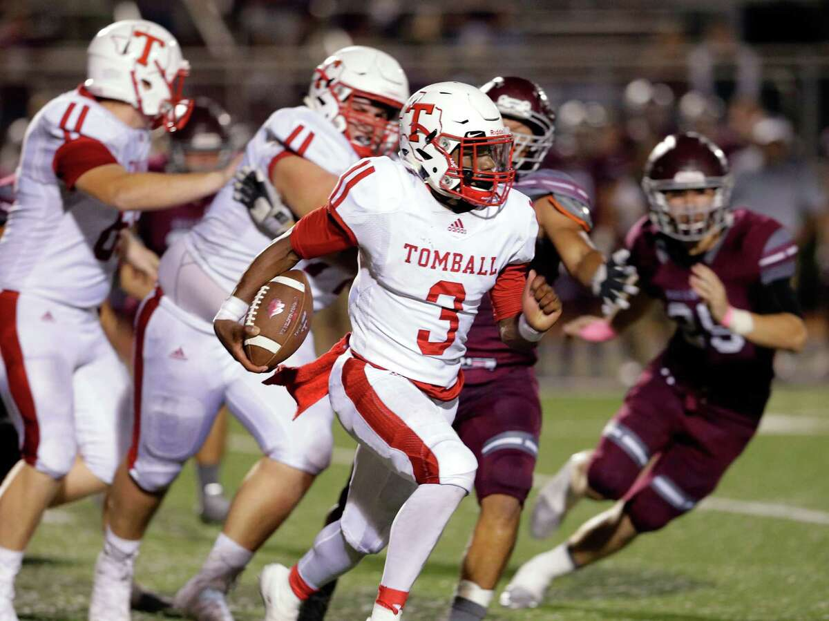 Tomball quarterback Tybo Taylor runs for a touchdown on a keeper play against Magnolia in the second half of their game at Bulldog Stadium in Magnolia, TX, Oct. 5, 2017. (Michael Wyke / For the Chronicle)