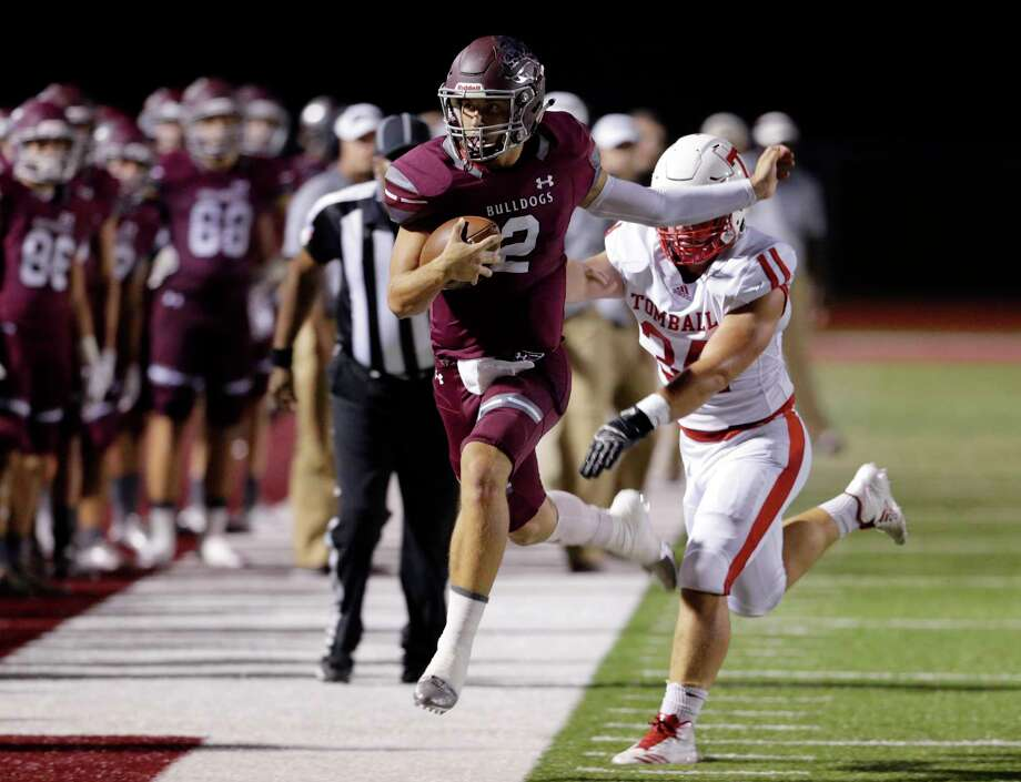 Magnolia quarterback Reese Mason, left, is pushed out of bounds by Tomball's Dakota Stirman at the end of this run in the first half of their game Friday night. Magnolia won 56-49. Photo: Michael Wyke, Freelance / © 2017 Houston Chronicle