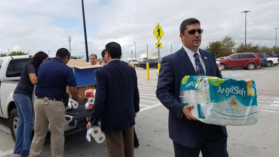 "District Attorney Isidro R. ""Chilo"" Alaniz helps volunteers unload items from a vehicle. Alaniz and local members of the community are asking Laredoans to help out victims of the earthquake in Mexico and hurricane victims in Puerto Rico. Photo: Cesar Rodriguez/Laredo Morning Times"