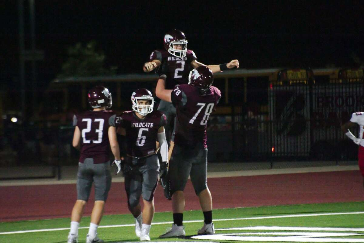 Clear Creek's Sam Mathews and Clear Creek's Chad Lindberg celebrate a touchdown against Clear Brook Friday, Sep. 6 at CCISD Challenger Columbia Stadium.