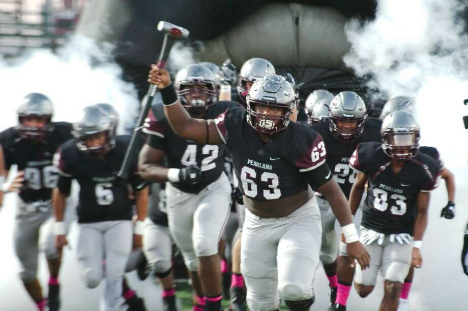 Pearland's Sincere Haynesworth (63) leads the team out on the field before the game against Alief Taylor Friday, Sep. 6 at Pearland High School. Photo: Kirk Sides/Houston Chronicle