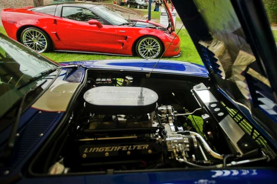 A Lingenfelter Corvette ZR1, top, and a Lingenfelter Superformance Grand Sport Corvette, bottom, are displayed during the Northwood University International Auto Show on Friday. The show opened Friday from 1 until 6 p.m. and continues today from 9 a.m. until 6 p.m. and Sunday from 10 a.m. until 5 p.m. (Katy Kildee/kkildee@mdn.net)