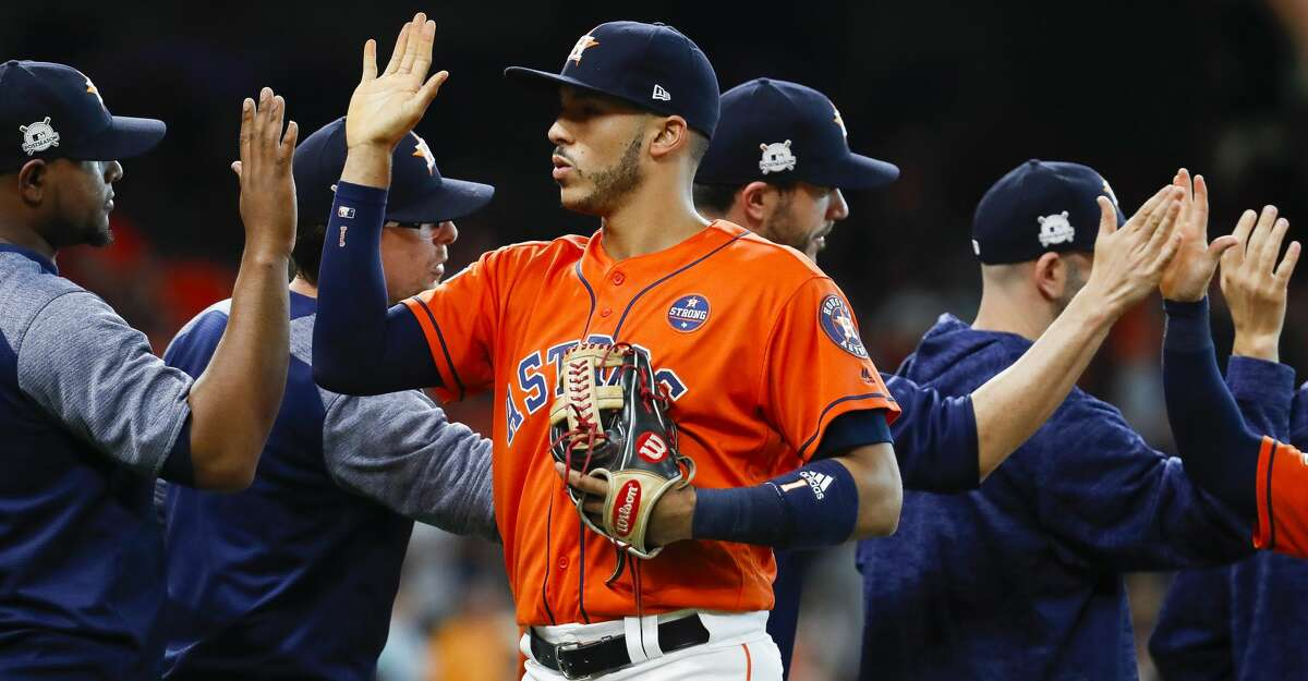 Houston Astros shortstop Carlos Correa (1) celebrates after the team's 8-2 win over the Boston Red Sox in Game 2 of the ALDS at Minute Maid Park on Friday, Oct. 6, 2017, in Houston. ( Karen Warren / Houston Chronicle )