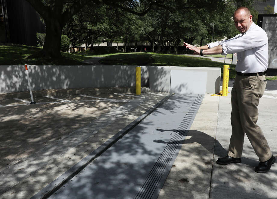 """Zane Gifford of Riverview Realty Partners talks about a flood gate that protects 3000 Post Oak. Gifford, the building's chief engineer, recalls when the building had none. """"You don't want to go through what we've been through. It's stressful,"""" he says. Photo: Elizabeth Conley, Houston Chronicle / © 2017 Houston Chronicle"""