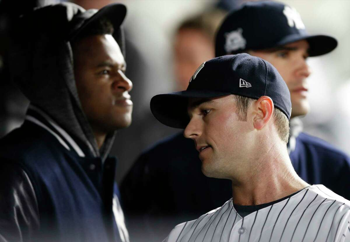 New York Yankees starting pitcher Luis Severino, left, watches the game as relief pitcher David Robertson reacts after Yankees manager Joe Girardi removed him with a Minnesota Twins runner on base and Joe Mauer batting, during the sixth inning of the American League wild-card playoff baseball game in New York, Tuesday, Oct. 3, 2017.