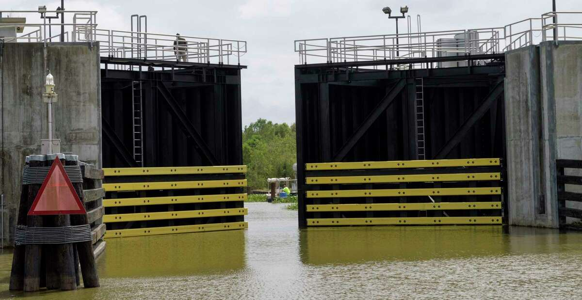 The Caernarvon floodgate closes in St. Bernard Parish before the arrival of Tropical Storm Nate in Caernarvon, La., Friday, Oct. 6, 2017. Many fisherman and crab trappers were allowed to dock their boats inside the floodgate at the St. Bernard Parish line before 1 p.m., Friday. (Matthew Hinton/The Advocate via AP)