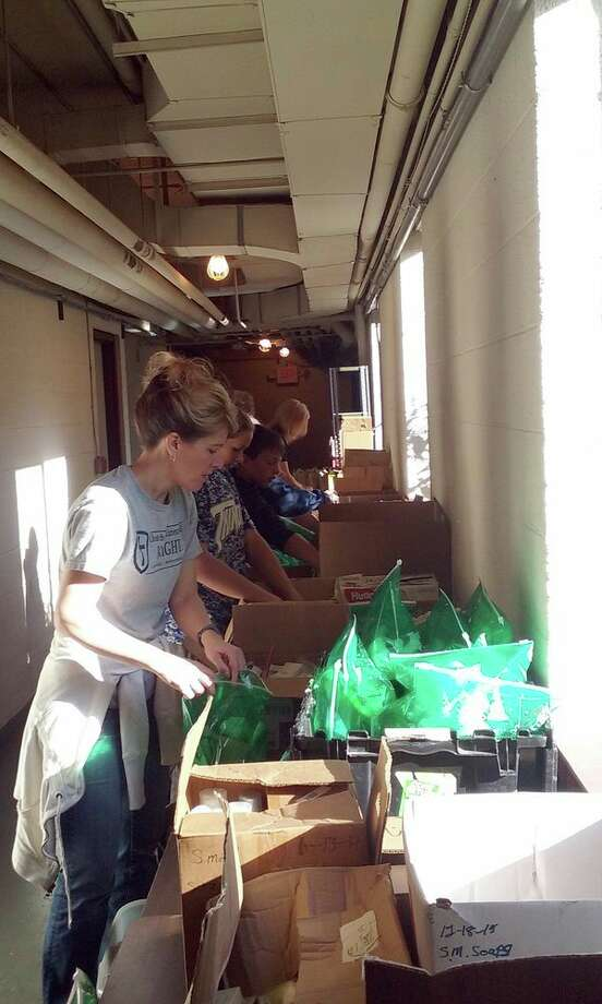 Christ the King students recently worked together to assemble hygiene packs, which will be distributed by the Good Samaritan Rescue Mission in late October at a food basket giveaway. (Submitted Photo)