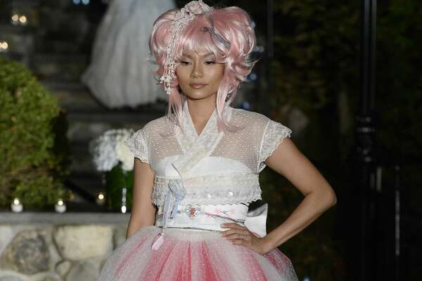 ROSLYN, NY - OCTOBER 05:  A model walks the Po de Arroz runway show at New York Fashion Week Bridal October 2017 at Hendrick's Tavern on October 5, 2017 in Roslyn, New York.  (Photo by Fernanda Calfat/Getty Images)