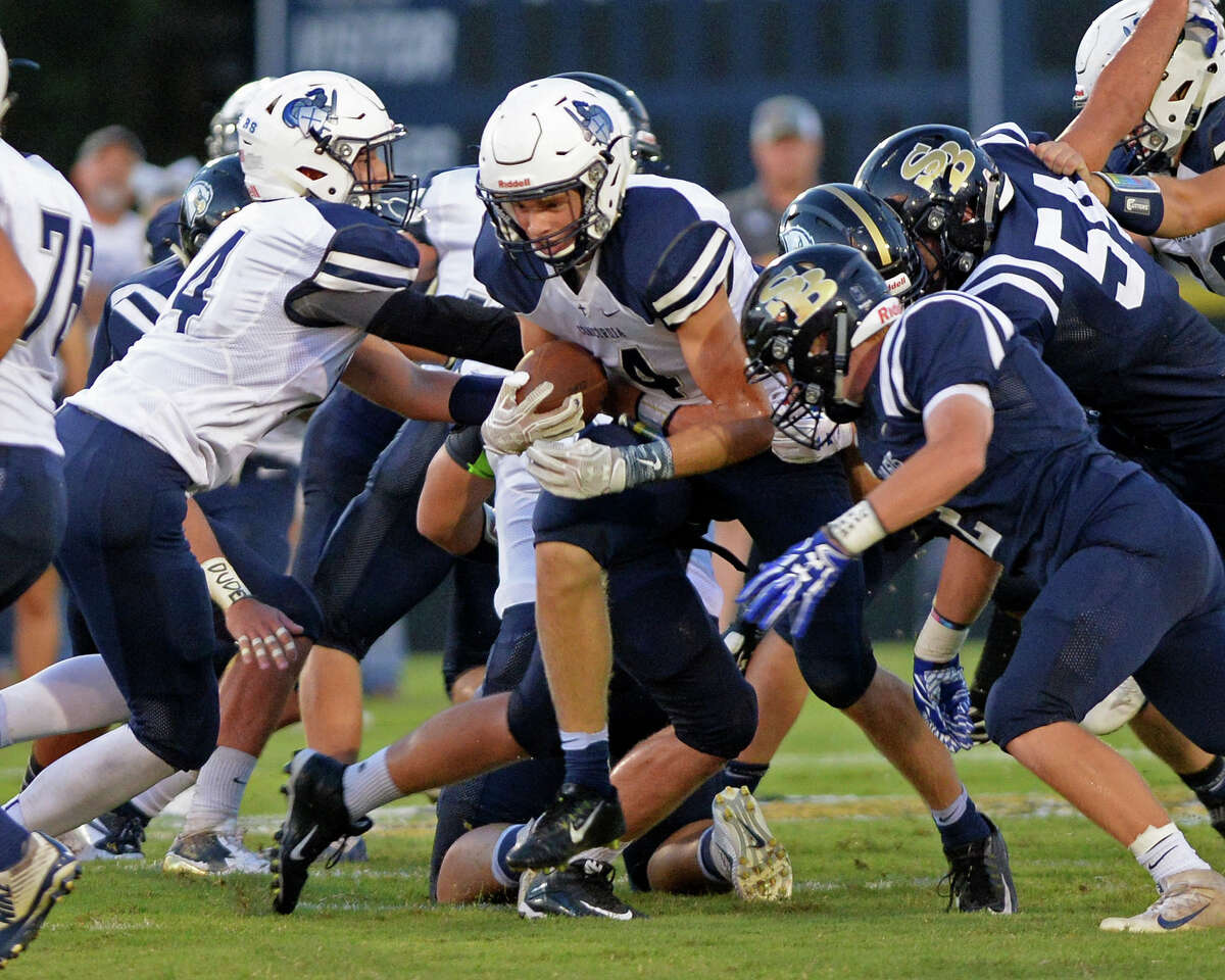 Colin Howard (4) of Concordia Lutheran breaks through the Second Baptist defense for a first down at the start of the second quarter of a high school football game between Second Baptist and Concordia Lutheran on September 9, 2016 at Second Baptist Woodway. Tomball Concordia Lutheran is 5-0 for the second time under ninth-year coach Bobby Lindquist.