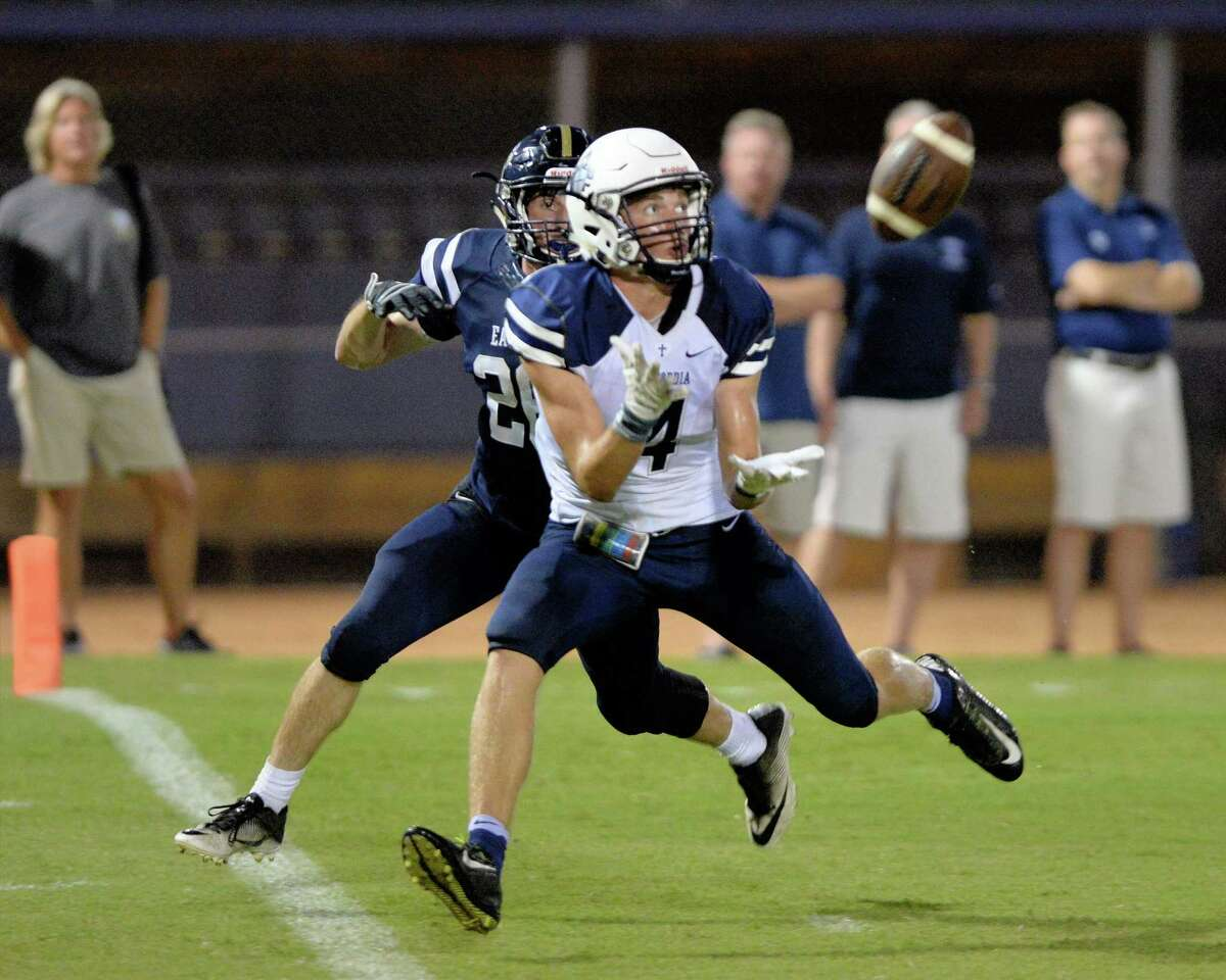 Colin Howard of Concordia Lutheran (4) hauls in a pass from Hunter McQuary (7) for a touchdown in the second quarter of a high school football game between Second Baptist and Concordia Lutheran on September 9, 2016 at Second Baptist Woodway. Tomball Concordia Lutheran is 5-0 for the second time under ninth-year coach Bobby Lindquist.