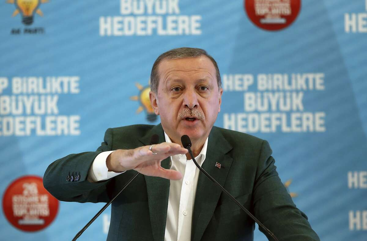 Turkey's President Recep Tayyip Erdogan, gestures as he delivers a speech at his ruling political party's conference in Afyonkarahisar province in western Turkey, Saturday, Oct. 7, 2017. Erdogan has announced the country is conducting a