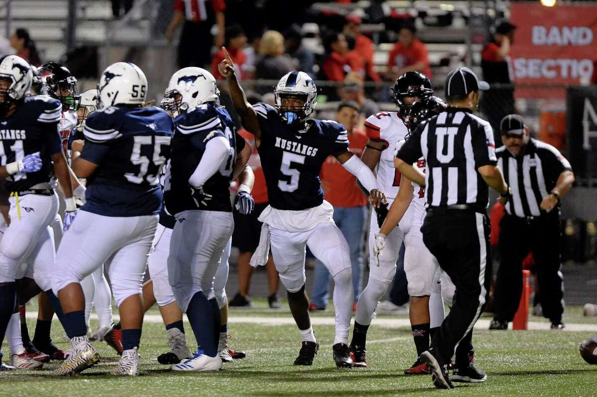 William Brown (5) of Lamar Consolidated celebrates after rushing for a touchdown in the third quarter of a high school football game between the Lamar Consolidated Mustangs and the Terry Rangers on October 6, 2017 at Traylor Stadium, Rosenberg, TX.