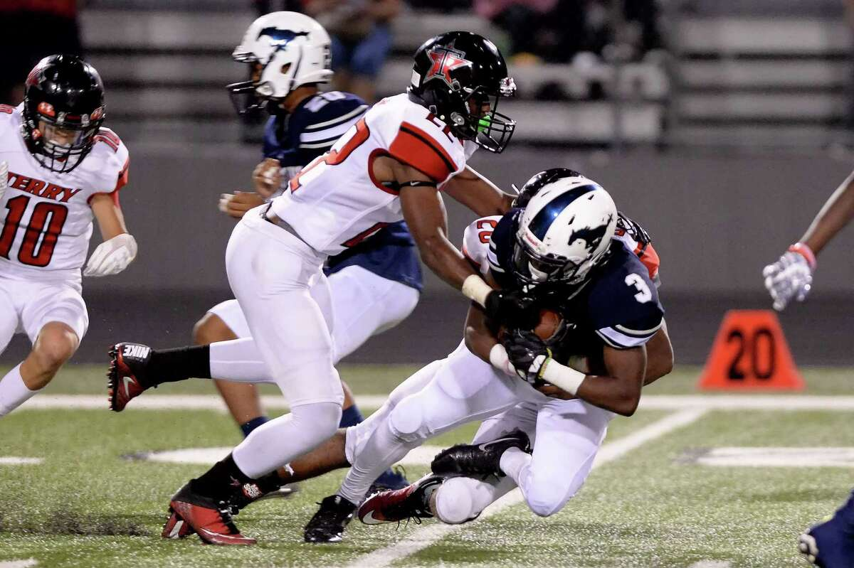 La'trell Davis (3) of Lamar Consolidated is tackled following a kickoff return in the second quarter of a high school football game between the Lamar Consolidated Mustangs and the Terry Rangers on October 6, 2017 at Traylor Stadium, Rosenberg, TX.