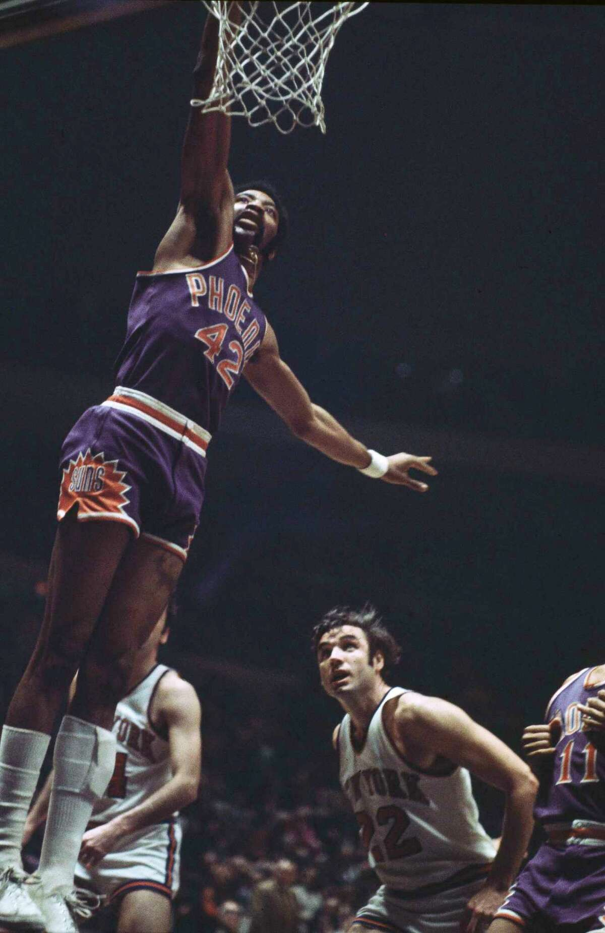 FILE - In this Feb. 16, 1971, file photo, Connie Hawkins of the Phoenix Suns goes to the basket against the New York Knicks at Madison Square Garden in New York. Basketball great Connie Hawkins has died at 75. The Hall of Famer's death was announced in a statement Saturday, Oct. 7, 2017, by the Phoenix Suns, the team with which he spent his most productive NBA seasons. The Suns told The Associated Press they confirmed the death with his family. The 6-foot-8 Hawkins was a dazzling playground legend in New York City who rose to basketball's heights. The Suns lauded his