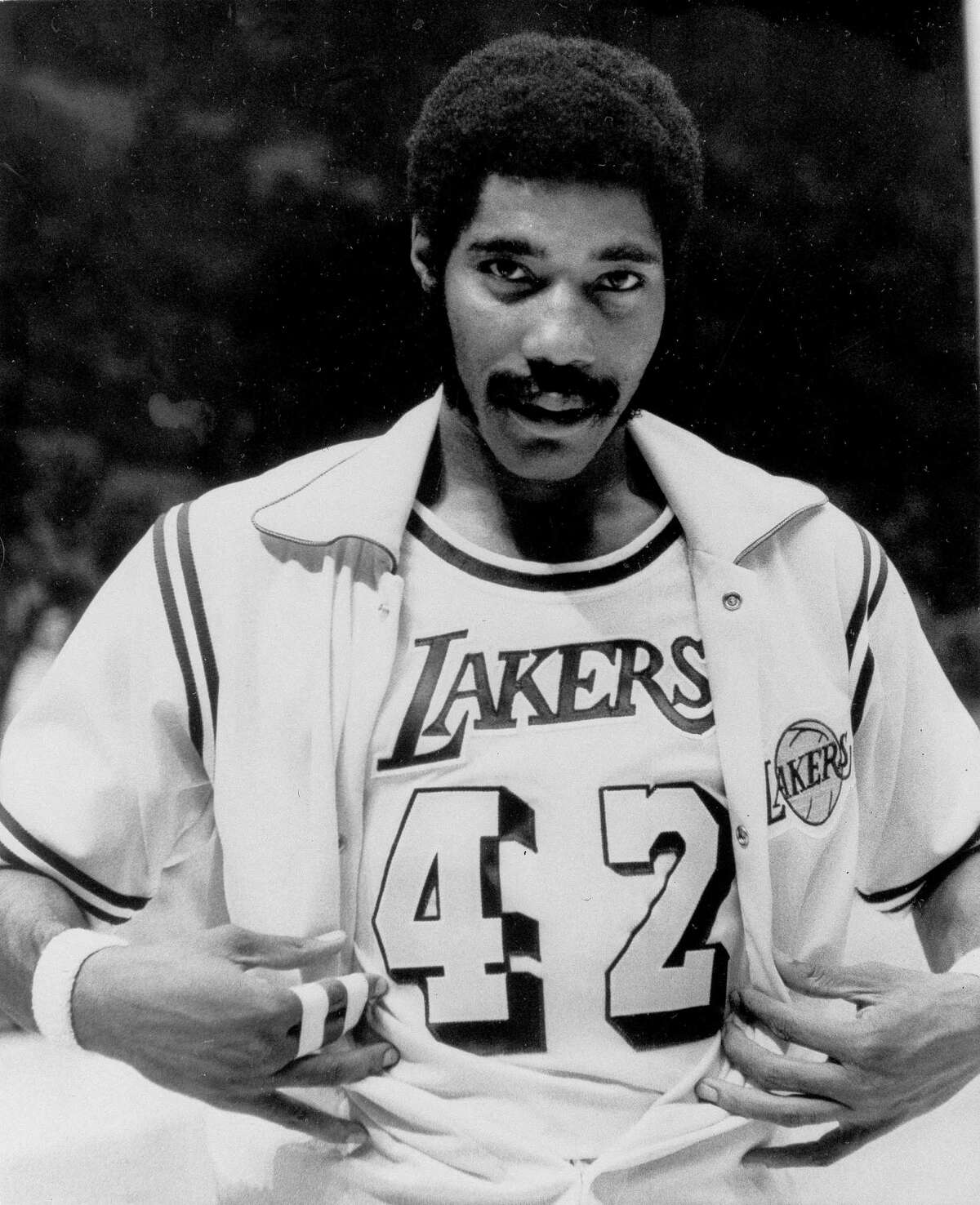 FILE - In this Nov. 2, 1973, file photo, Connie Hawkins shows off his new Los Angeles Lakers uniform before start of game against the New York Knicks in Inglewood, Calif. Basketball great Connie Hawkins has died at 75. The Hall of Famer's death was announced in a statement Saturday, Oct. 7, 2017, by the Phoenix Suns, the team with which he spent his most productive NBA seasons. The Suns told The Associated Press they confirmed the death with his family. The 6-foot-8 Hawkins was a dazzling playground legend in New York City who rose to basketball's heights. The Suns lauded his