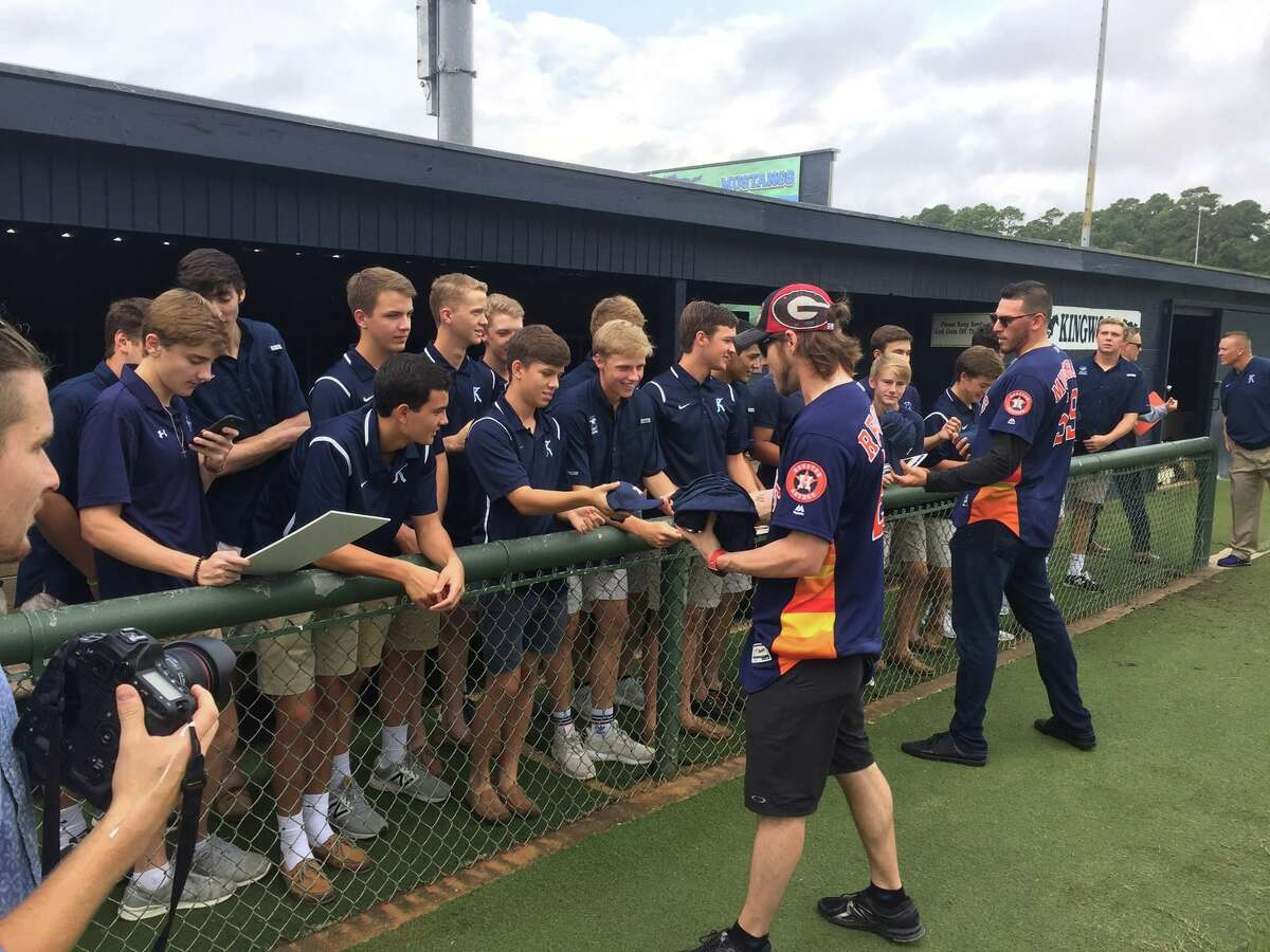 Houston Astros outfielder Josh Reddick and pitcher Joe Musgrove talk to the Kingwood High School baseball team and sign autographs for them after surprising them at practice Tuesday morning