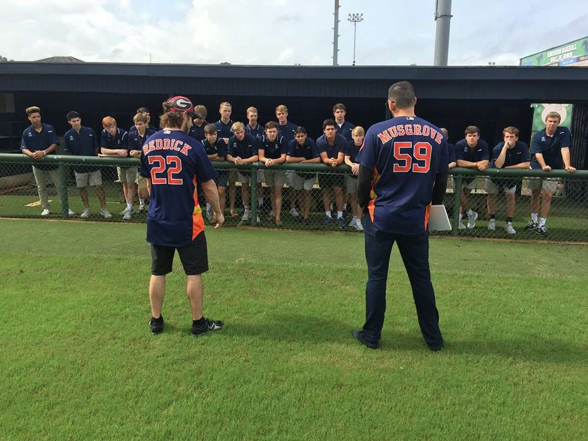 Houston Astros outfielder Josh Reddick and pitcher Joe Musgrove talk to the Kingwood High School baseball team after surprising them at practice Tuesday morning