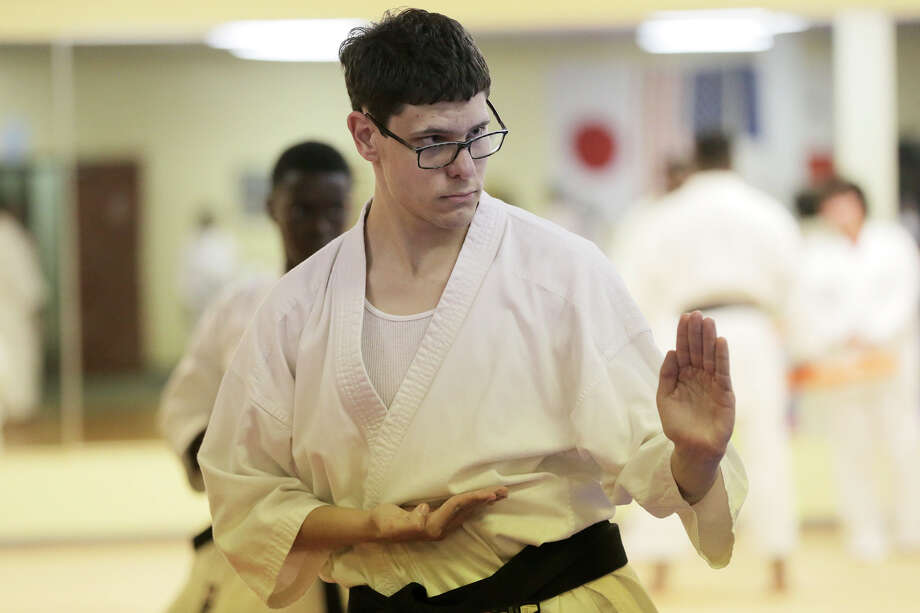 Mike Griffith, who has autism, practices at Dai-Ichi karate school on Wednesday, Oct. 4, 2017, in Missouri City. ( Elizabeth Conley / Houston Chronicle ) Photo: Elizabeth Conley, Houston Chronicle / © 2017 Houston Chronicle