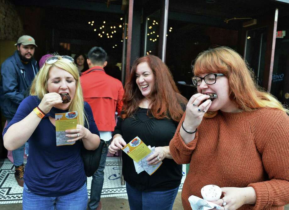 Chicken wing fanciers from left, Isabel Daggett of Ravena, Amy Murdoch of Scotia and Justine Aver of Albany sample the fare from Aperitivo Bistro during the 6th Annual Wing Walk Saturday Oct. 7, 2017 in Schenectady, NY.  (John Carl D'Annibale / Times Union) Photo: John Carl D'Annibale / 20041791A