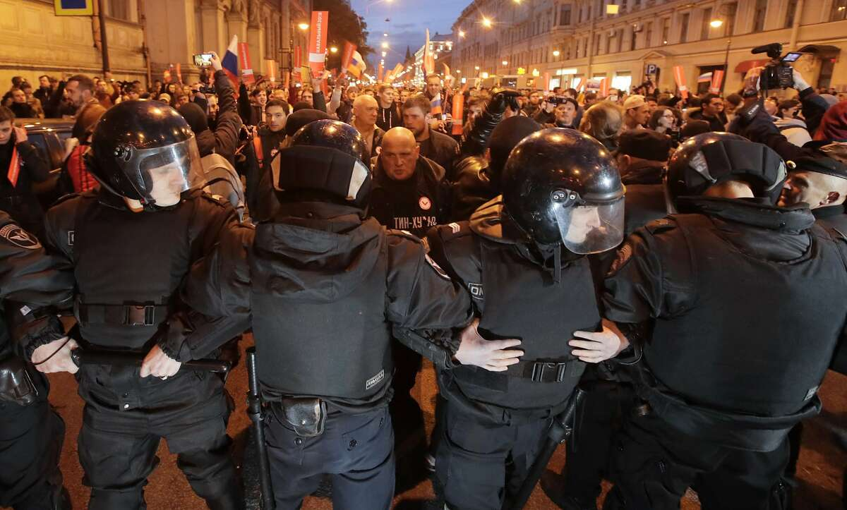 Riot police officers block the way to protesters during a rally in St. Petersburg, Russia, Saturday, Oct. 7, 2017. In a challenge to President Vladimir Putin on his 65th birthday, protesters rallied across Russia on Saturday, heeding opposition leader Alexei Navalny�s call to pressure authorities into letting him enter the presidential race. (AP Photo/Dmitri Lovetsky)