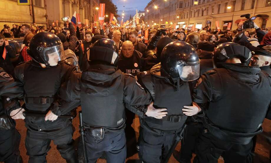 Police in St. Petersburg try to block protesters from advancing. Opposition leader Alexei Navalny called for the rallies to pressure authorities into letting him enter the presidential race. Photo: Dmitri Lovetsky, Associated Press