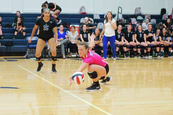 Friendswood's Kylie Lockhart (right) and Zeyanna Dhalla helped the Lady Mustangs open a two-game district lead with a four-set win over Clear Falls Friday night.