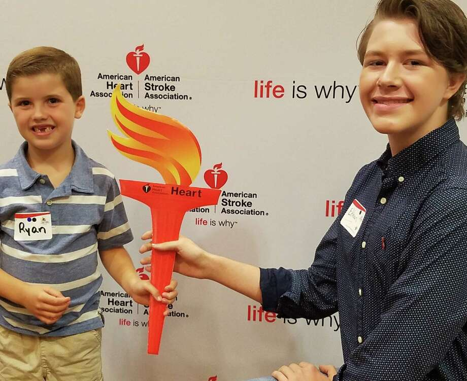 ALBANY ? Ryan Galvin, 6, of Ballston Spa, Heart Hero of the 2017 Capital Region Heart Walk and Run, on Sept. 26 passed the torch to 14-year-old Ethan Byron at The Heart of Our Mission event on Tuesday, Sept. 26 at the Albany Marriott.  Ethan of Clifton Park is the Heart Hero of the 2018 Capital Region Heart Walk and Run. Both were born with congenital heart defects and work with the American Heart Association to raise awareness bout heart disease and stroke, and funds to fight those diseases.  For information about the 2018 Capital Region Heart Walk and Run, set for June 3, visit CapitalRegionHeartWalk.org.