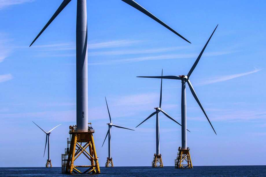 FILE -- Wind farm turbines near Block Island, R.I., May 13, 2017. In the months since President Donald Trump declared that the U.S. would withdraw from the Paris climate deal, 14 state governors have vowed to continue upholding the agreement and press ahead with policies to fight global warming. Historically, the federal government has led the way in researching and developing technologies like wind and solar power. (Chang W. Lee/The New York Times) ORG XMIT: XNYT171 Photo: CHANG W. LEE / NYTNS