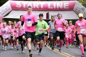 Runners begin the 6th annual Pounding the Pavement for Pink 5K walk and run in Seymour on October 7, 2017.