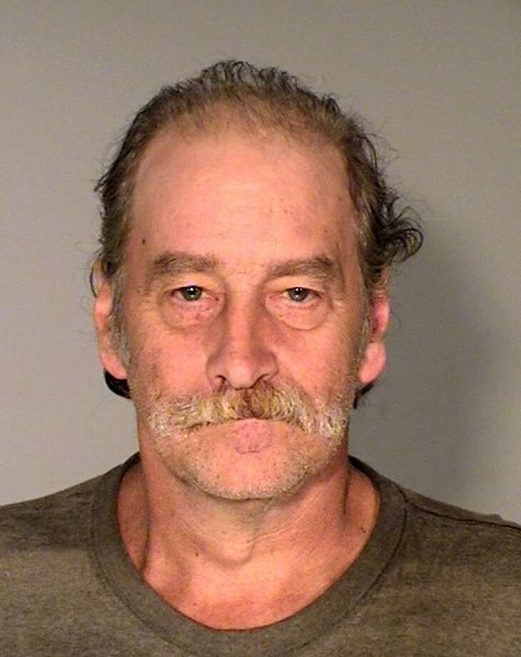Robert Kuefler, shown above in this mug shot from the Ramsey County Sheriff's Office, lived with the dead bodies of his mother, brother for a year, according to law enforcement officials. Photo: Ramsey County Sheriff's Office