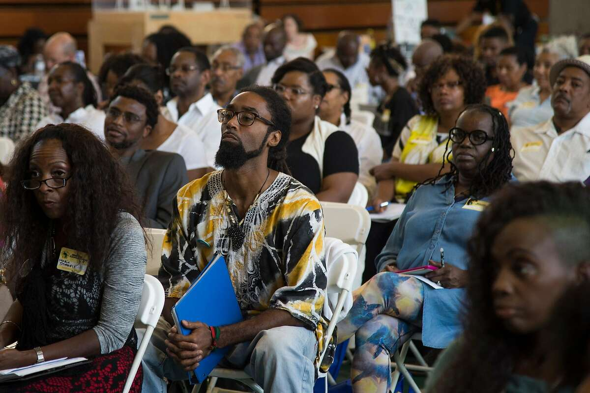 A crowd listens to Rep. Barbara Lee speak during a panel discussion at Making Connections IV at Laney College in Oakland, Calif. on Oct. 6, 2017.