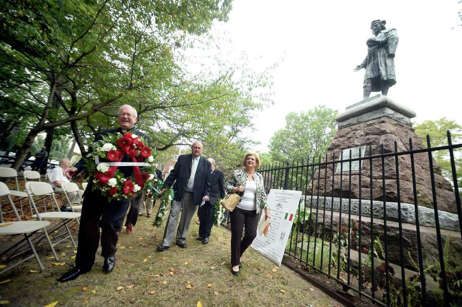 Left to right, Monsignor Gerard Schmitz of the Church of St. Michael, Paul Criscuolo, president of the Columbus Day Committee, and Laura Florio Luzzi, chairman of the board of the Columbus Day Committee, arrive at the statue of Christopher Columbus for the annual Wreath Presentation Ceremony in Wooster Square in New Haven on October 7, 2017. Photo: Arnold Gold / Hearst Connecticut Media / New Haven Register