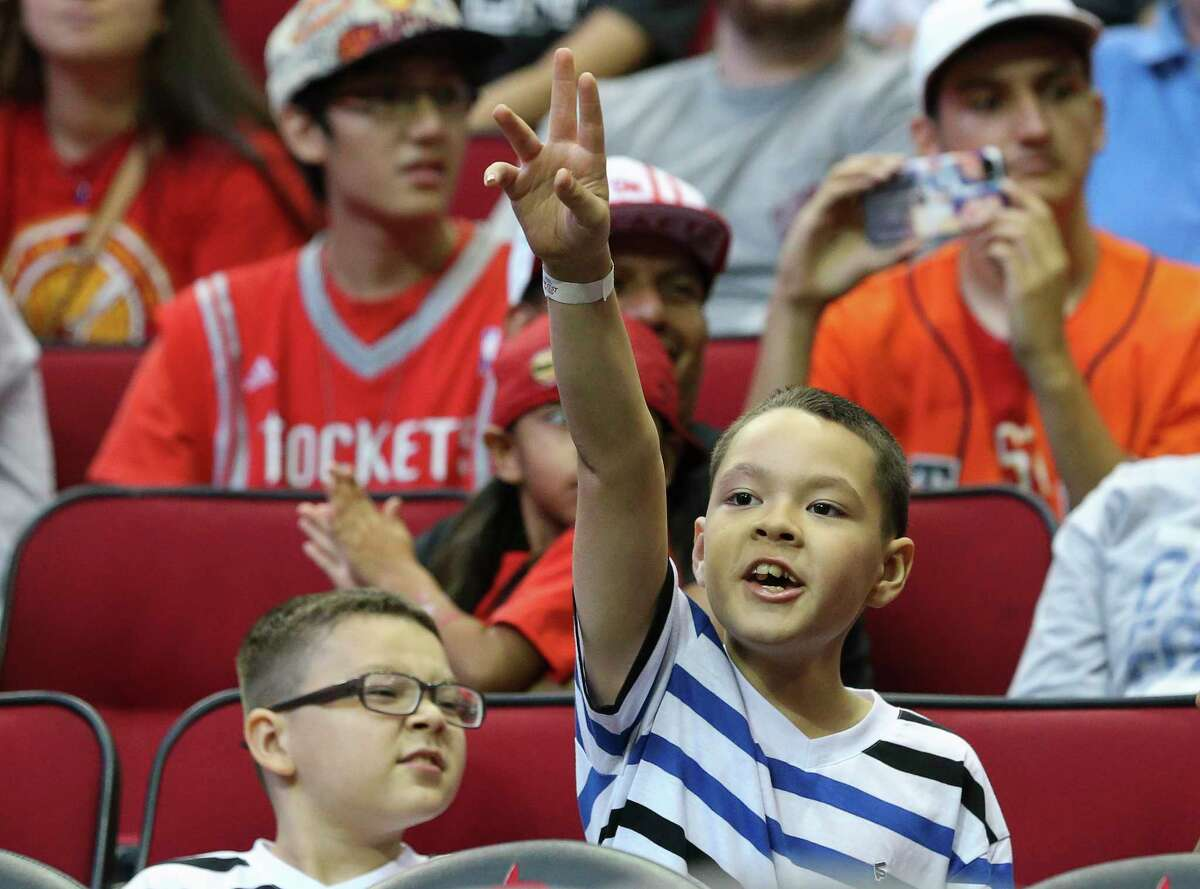 Houston Rockets fans cheer for players during the practice game at the fan fest at Toyota Center Saturday, Oct. 7, 2017, in Houston.