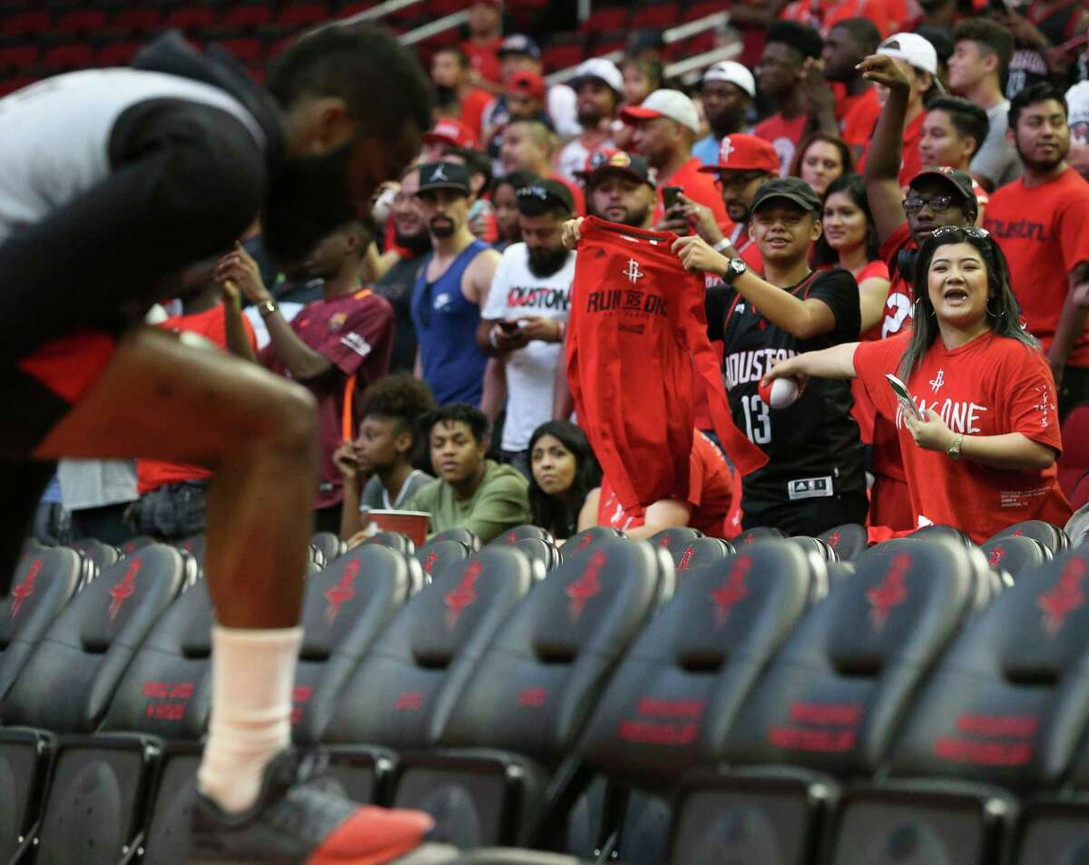 Houston Rockets fans try to get James Harden's attention before the practice game at the fan fest at Toyota Center Saturday, Oct. 7, 2017, in Houston.