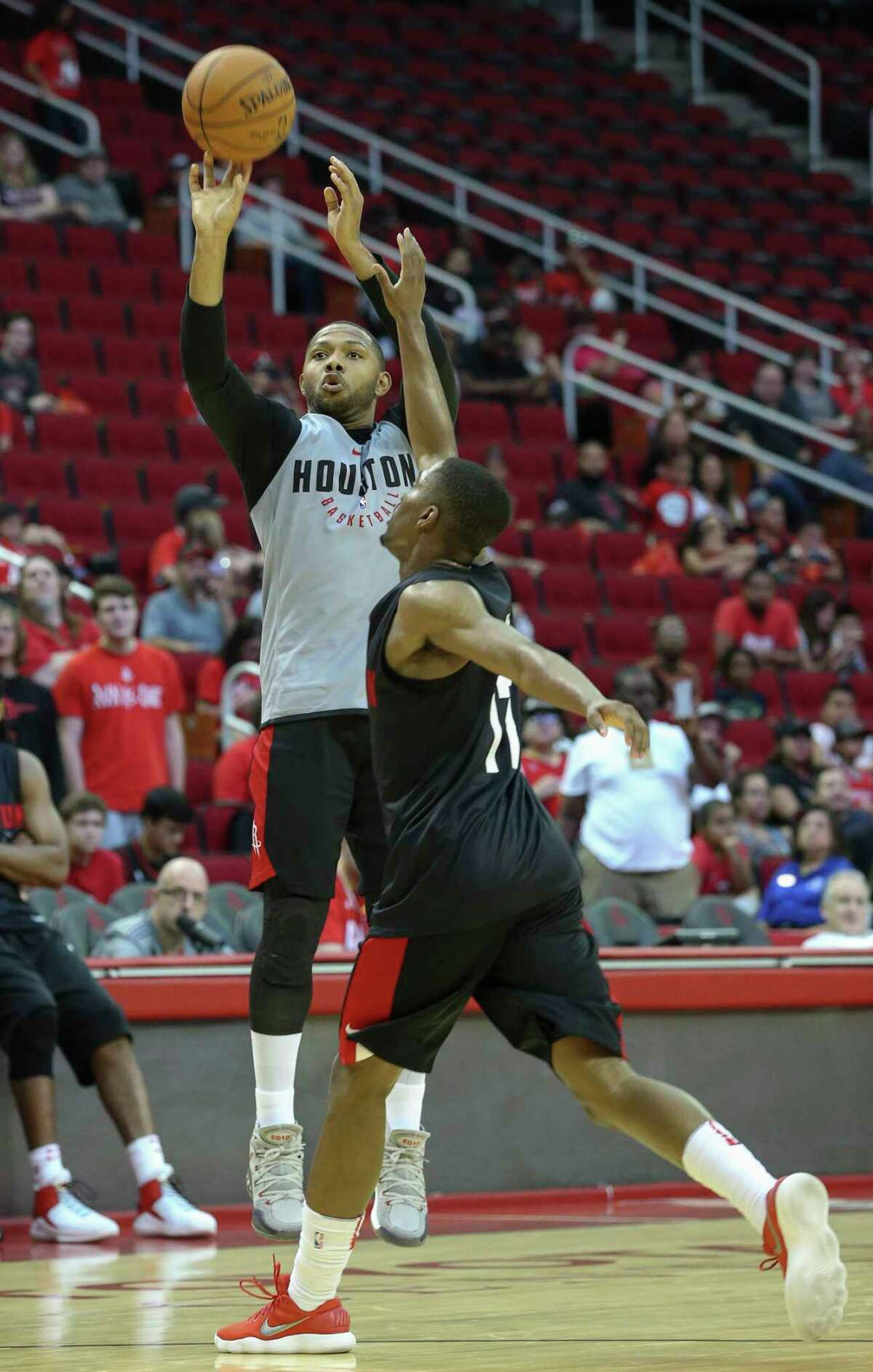 Houston Rockets' Eric Gordon shoots the basket during the practice game at the fan fest at Toyota Center Saturday, Oct. 7, 2017, in Houston.