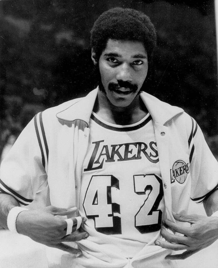 "FILE - In this Nov. 2, 1973, file photo, Connie Hawkins shows off his new Los Angeles Lakers uniform before start of game against the New York Knicks in Inglewood, Calif. Basketball great Connie Hawkins has died at 75. The Hall of Famer's death was announced in a statement Saturday, Oct. 7, 2017,  by the Phoenix Suns, the team with which he spent his most productive NBA seasons. The Suns told The Associated Press they confirmed the death with his family. The 6-foot-8 Hawkins was a dazzling playground legend in New York City who rose to basketball's heights. The Suns lauded his ""unique combination of size, grace and athleticism."" (AP Photo/David Smith) Photo: David Smith, Associated Press"