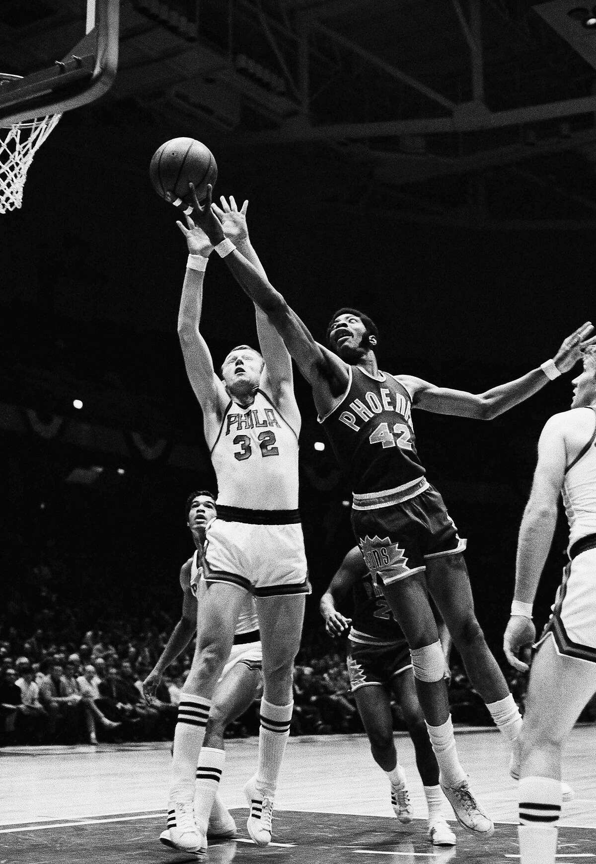 FILE - In this Oct. 22, 1969, file photo, Connie Hawkins (42) of the Phoenix Suns goes to the basket past Billy Cunningham (32) of the Philadelphia 76ers during the first half of a game in Philadelphia. Basketball great Connie Hawkins has died at 75. The Hall of Famer's death was announced in a statement Saturday, Oct. 7, 2017, by the Phoenix Suns, the team with which he spent his most productive NBA seasons. The Suns told The Associated Press they confirmed the death with his family. The 6-foot-8 Hawkins was a dazzling playground legend in New York City who rose to basketball's heights. The Suns lauded his