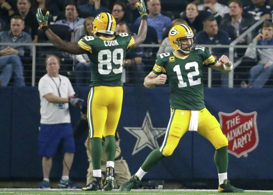 In this Jan. 15, 2017, file photo, Green Bay Packers' Aaron Rodgers (12) and Jared Cook (89) celebrate after a touchdown during the first half of an NFL divisional playoff football game against the Dallas Cowboys in Arlington. Photo: Tony Gutierrez /Associated Press / Copyright 2017 The Associated Press. All rights reserved.