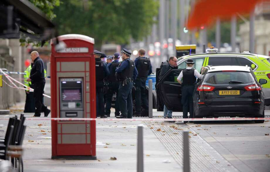 Britain's Police at the scene of an incident in central London, Saturday, Oct. 7, 2017. London police say emergency services are outside the Natural History Museum in London after a car struck pedestrians. (AP Photo/Alastair Grant) Photo: Alastair Grant, STF / Copyright 2017 The Associated Press. All rights reserved.