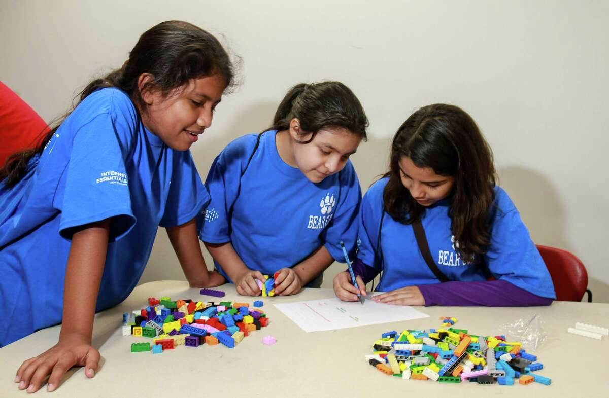 Jennifer Fernandez, from left, Mariana Castillo and Naomi Loera, all 11-years-old, at Houston Community College designing and building a Lego boat. This is part of the Comcast TechPak program. (For the Chronicle/Gary Fountain, October 7, 2017)