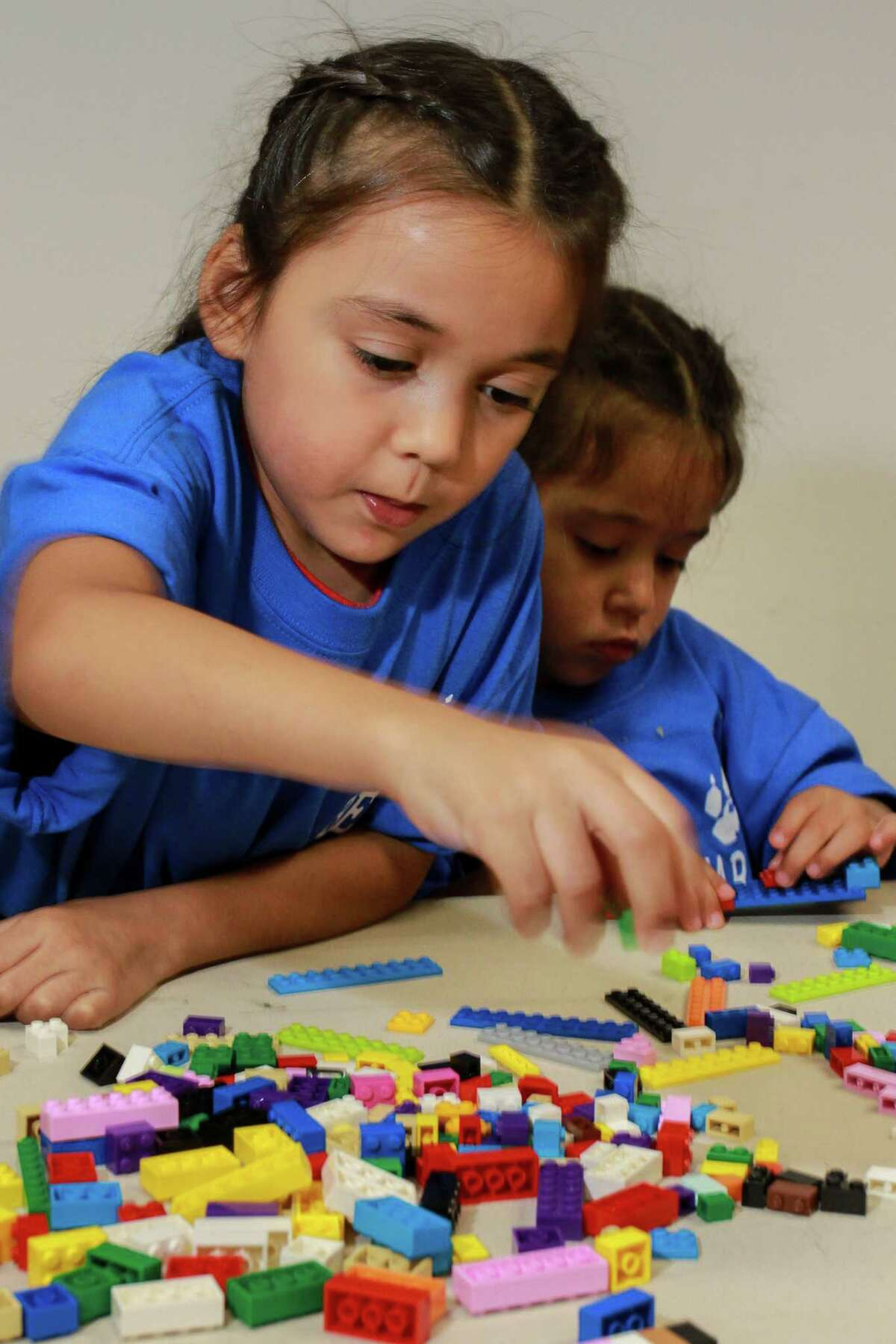 Sisters Emma Pruneda, 6, and Elaine Pruneda, 4, design and build a Lego boat as the learn about careers in STEM fields, part of the Comcast TechPak program. (For the Chronicle/Gary Fountain, October 7, 2017)