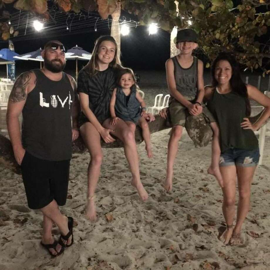 Hannah Ahlers, who died during the Las Vegas massacre, with her husband and children. (Contributed photo.)