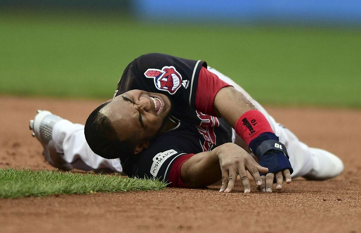 Cleveland Indians' Edwin Encarnacion grimaces after rolling his ankle trying to get back to second base in the second inning against the New York Yankees in Game 2 of a baseball American League Division Series, Friday, Oct. 6, 2017, in Cleveland. (AP Photo/David Dermer)
