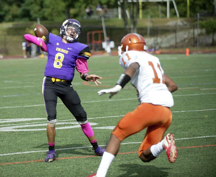 Westhill's AJ Laccona throws a pass during Saturday's game against Capital Achievement Prep at Westhill High School on October 7, 2017. Photo: Lindsay Perry / For Hearst Connecticut Media / Stamford Advocate Freelance