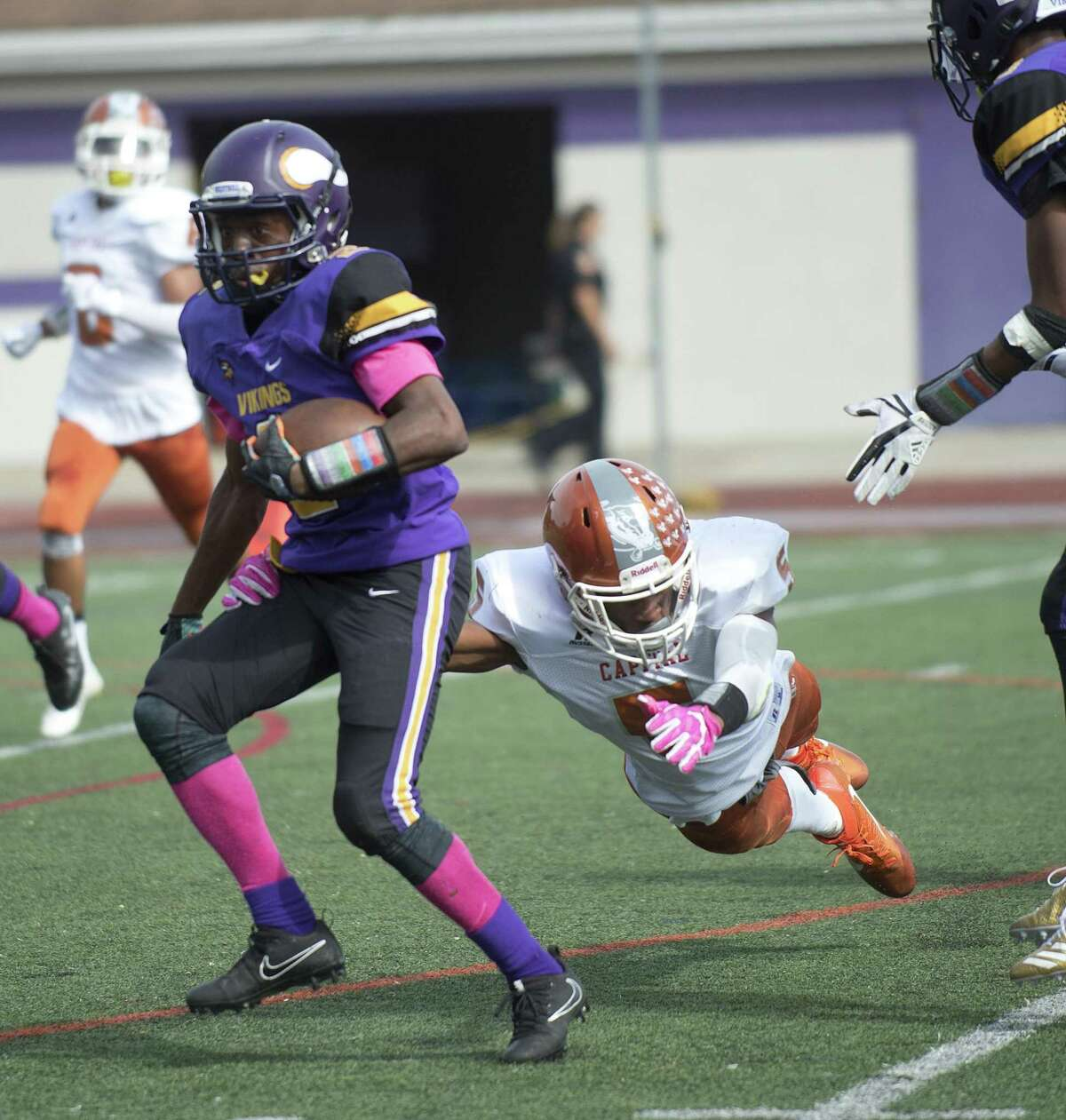 Capital Achievement's Oniel Robinson dives for Westhill's Noldylens Metayer during Saturday's game against Capital Achievement Prep at Westhill High School on October 7, 2017.