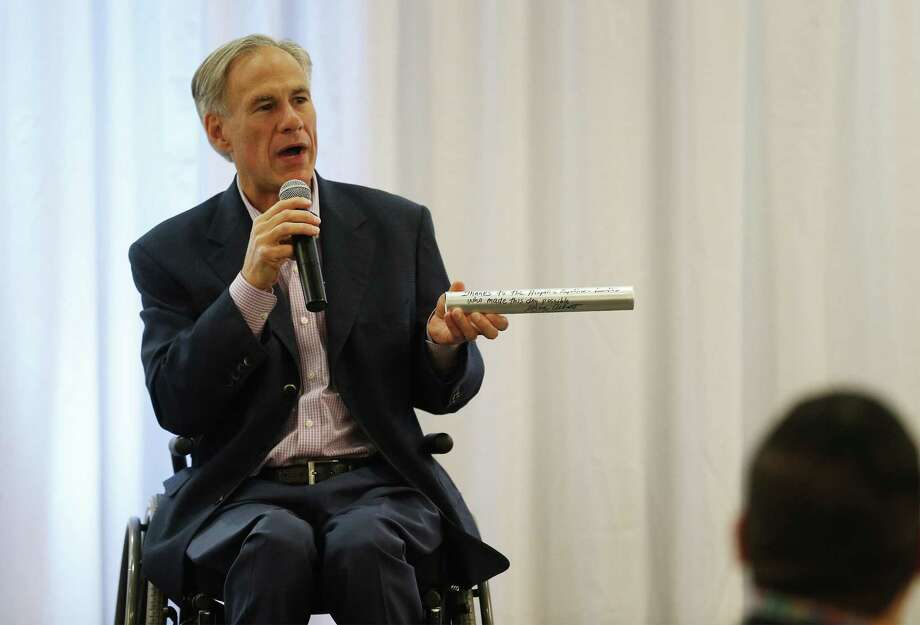 "Texas Governor Greg Abbott addresses an audience at the Hispanic Leadership Conference at Norris Conference Center on Saturday, Oct. 7, 2017. During his speech, Abbott presented a relay baton which he said would pass on to a Hispanic Republican who took office as a sign of progress for the party. Abbott wrote on the baton: ""Thanks to the Hispanic Republican Leaders who made this day possible."" Abbott also spoke glowingly about his wife's Hispanic upbringing, on the strength of the Texas economy and his intention to run for re-election for governor to the mostly conservative Hispanic audience. The conference had the hashtag: #imwithabbott and #estoyconabbott. Before Abbott's speech, a rally of about 36 people held by Texas Democrats took place near the site of the conference but was disbanded by security citing private property laws. (Kin Man Hui/San Antonio Express-News) Photo: Kin Man Hui, Staff / San Antonio Express-News / ©2017 San Antonio Express-News"