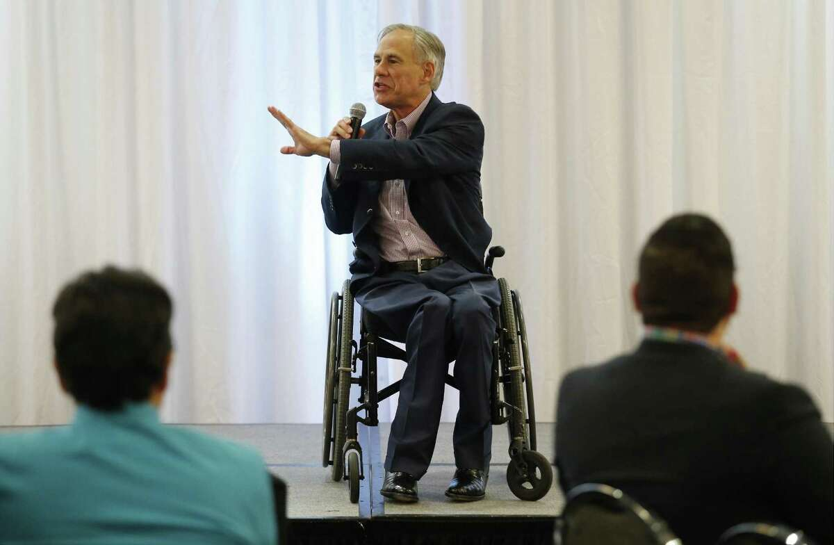 Texas Governor Greg Abbott addresses an audience at the Hispanic Leadership Conference at Norris Conference Center on Saturday, Oct. 7, 2017. Abbott spoke glowingly about his wife's Hispanic upbringing, on the strength of the Texas economy and his intention to run for re-election for governor to the mostly conservative Hispanic audience. The conference had the hashtag: #imwithabbott and #estoyconabbott. Before Abbott's speech, a rally of about 36 people held by Texas Democrats took place near the site of the conference but was disbanded by security citing private property laws. (Kin Man Hui/San Antonio Express-News)