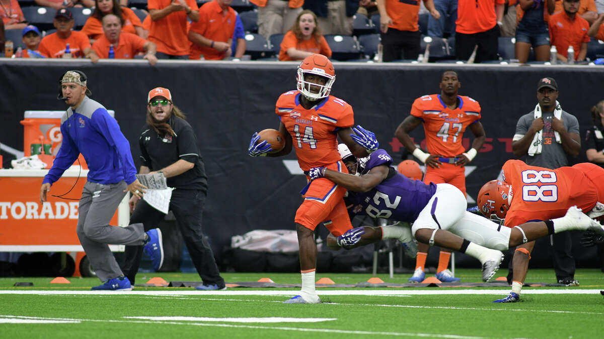 Sam Houston State junior wide receiver Davion Davis (14) tries to break away from Stephen F. Austin defender Jamall Shaw (32) on his reception late in the 2nd quarter of their Battle of the Piney Woods clash at NRG Stadium in Houston on Saturday, Oct. 7, 2017. (Photo by Jerry Baker/Freelance)
