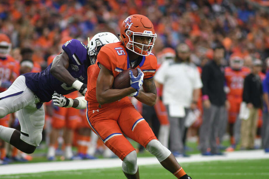 Sam Houston State sophomore wide receiver Coree Compton (15) tries to break free of Stephen F. Austin defender Lawrence Ghansah (3) in front of the goal line late in the 2nd quarter of their Battle of the Piney Woods clash at NRG Stadium in Houston on Saturday, Oct. 7, 2017. (Photo by Jerry Baker/Freelance) Photo: Jerry Baker/For The Chronicle